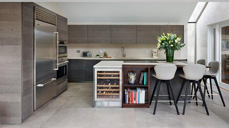 concrete and dark walnut finished kitchen