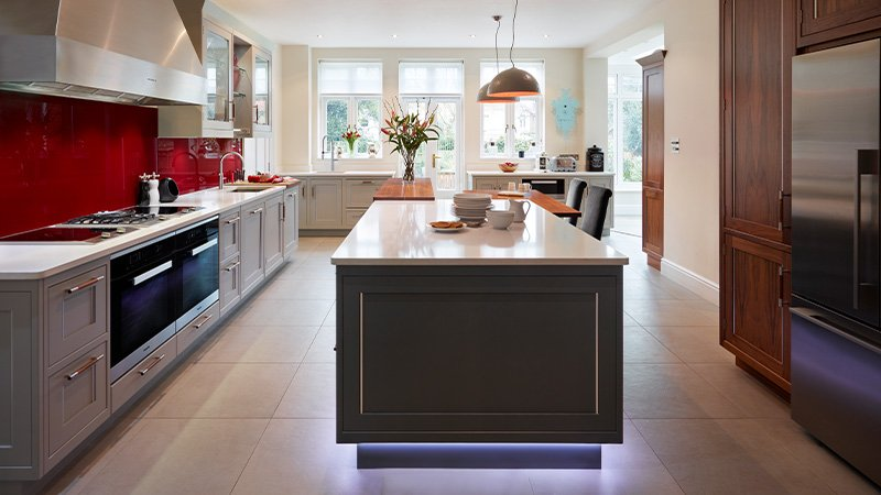 davonport kitchen with large cooking area and island with under lighting