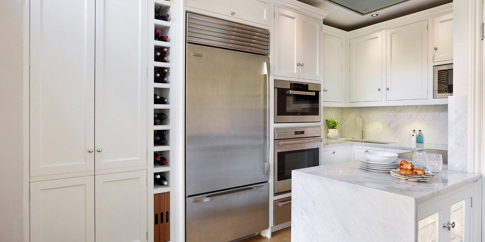 gally kitchen with sub zero fridge freezer