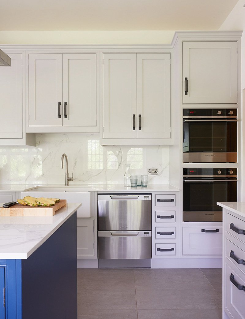 hand painted kitchen with fisher and paykel appliances in stainless steel