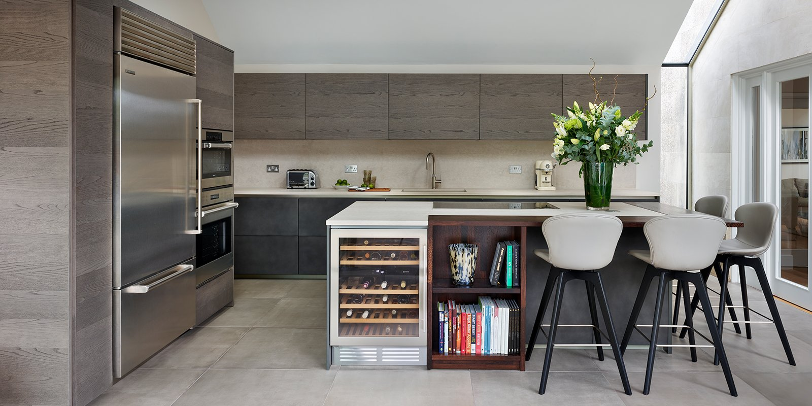 hunting lodge kitchen with concrete and dark walnut