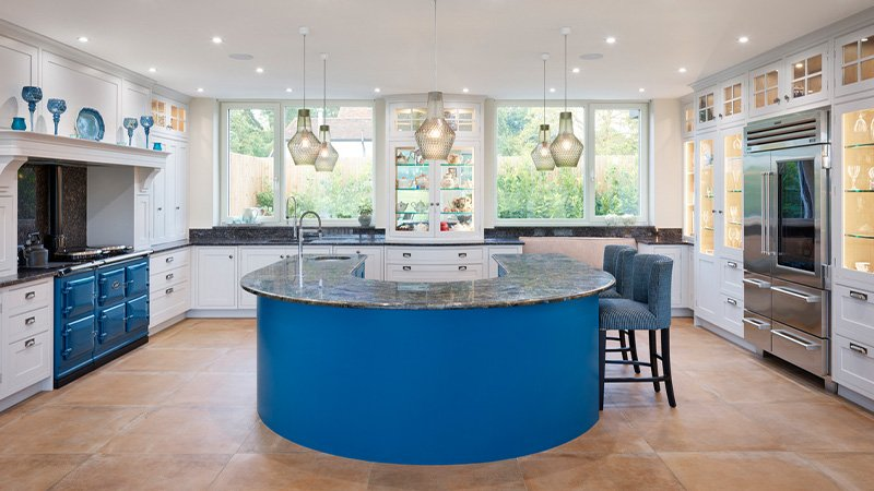 jane cheel kitchen with large circular island and seating area