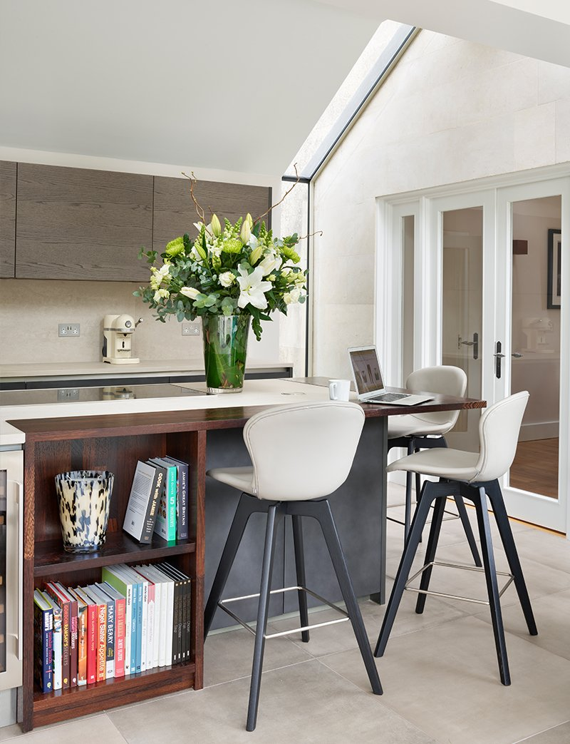 kitchen island with seating area and book shelves