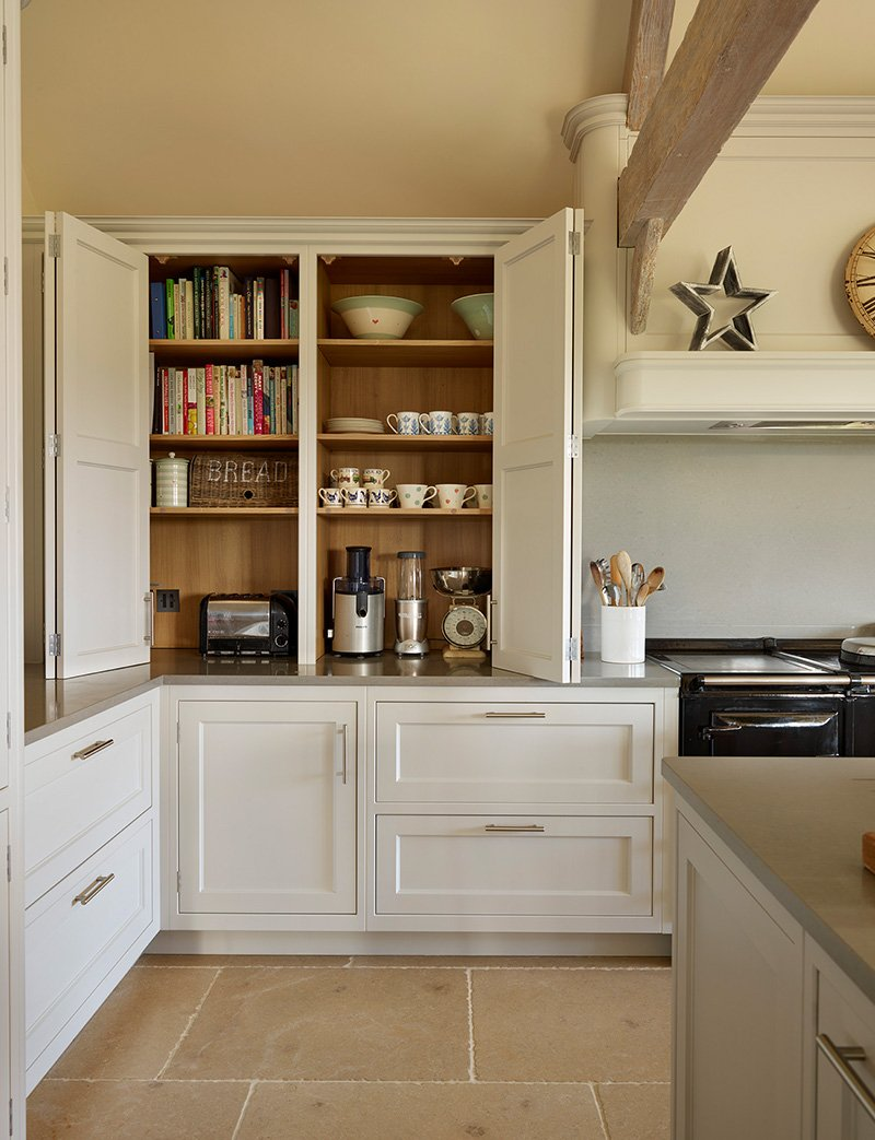 kitchen with storage cupboards for making drinks