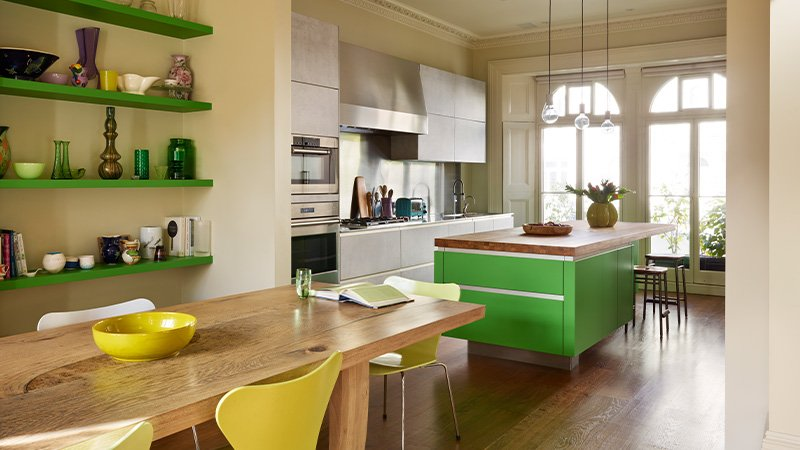 large kitchen with lime green finish