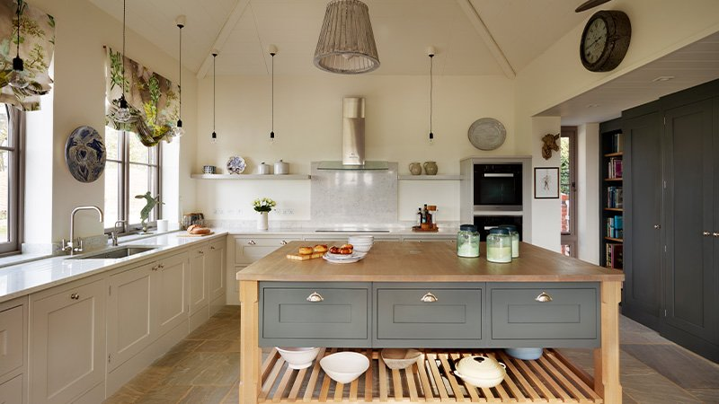 open island kitchen with a utility room and pantry
