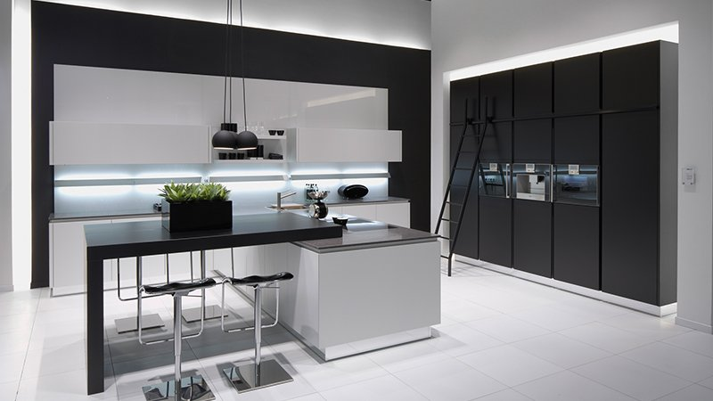 pronorm kitchen in greys with seating area