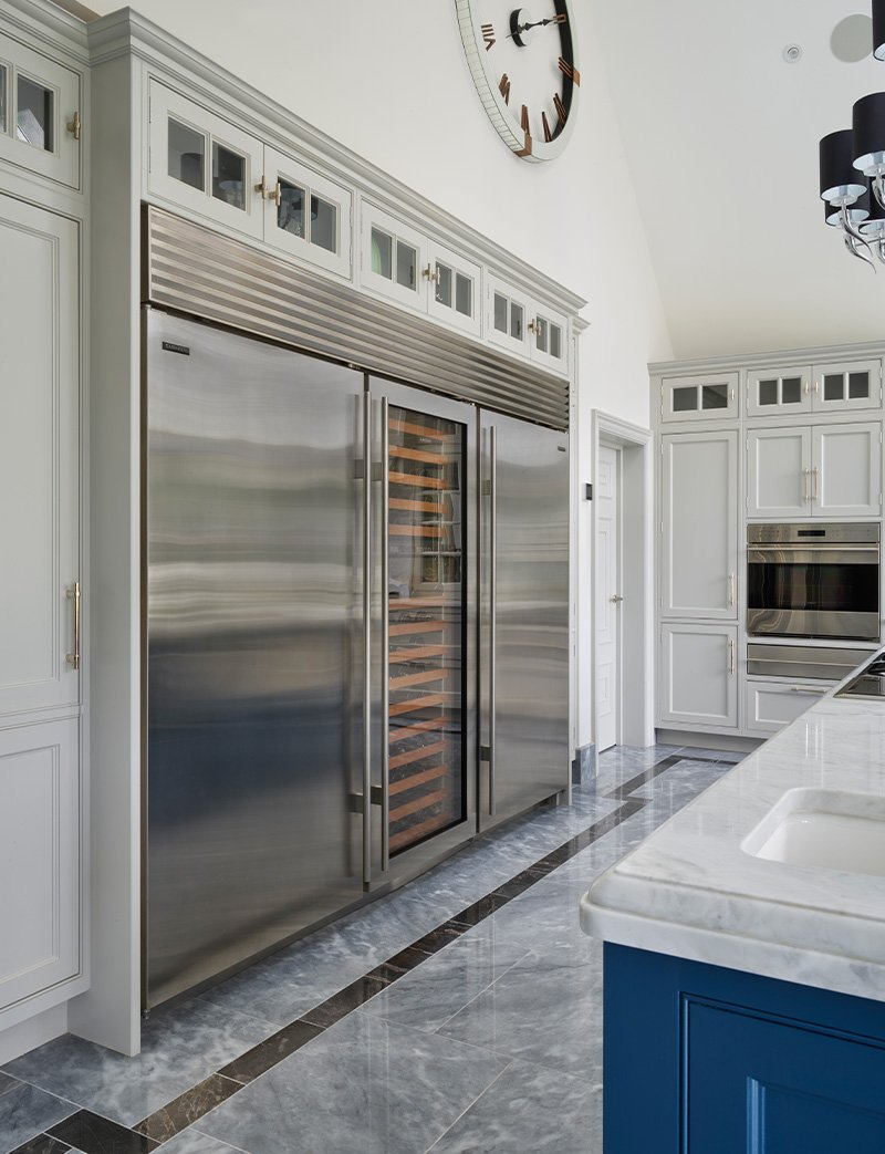 stainless steel refrigeration to one side of the kitchen