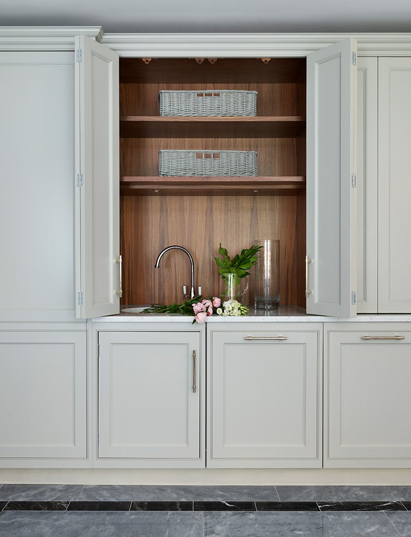utility cupboards with hidden sink for flowers