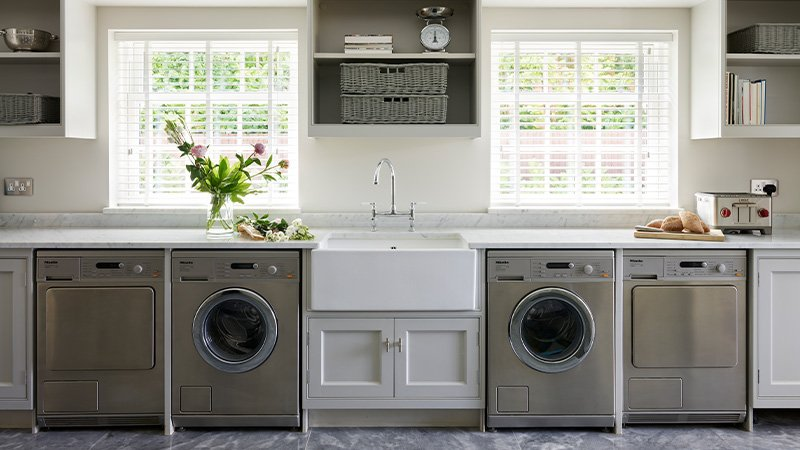 utility room with appliances and storage