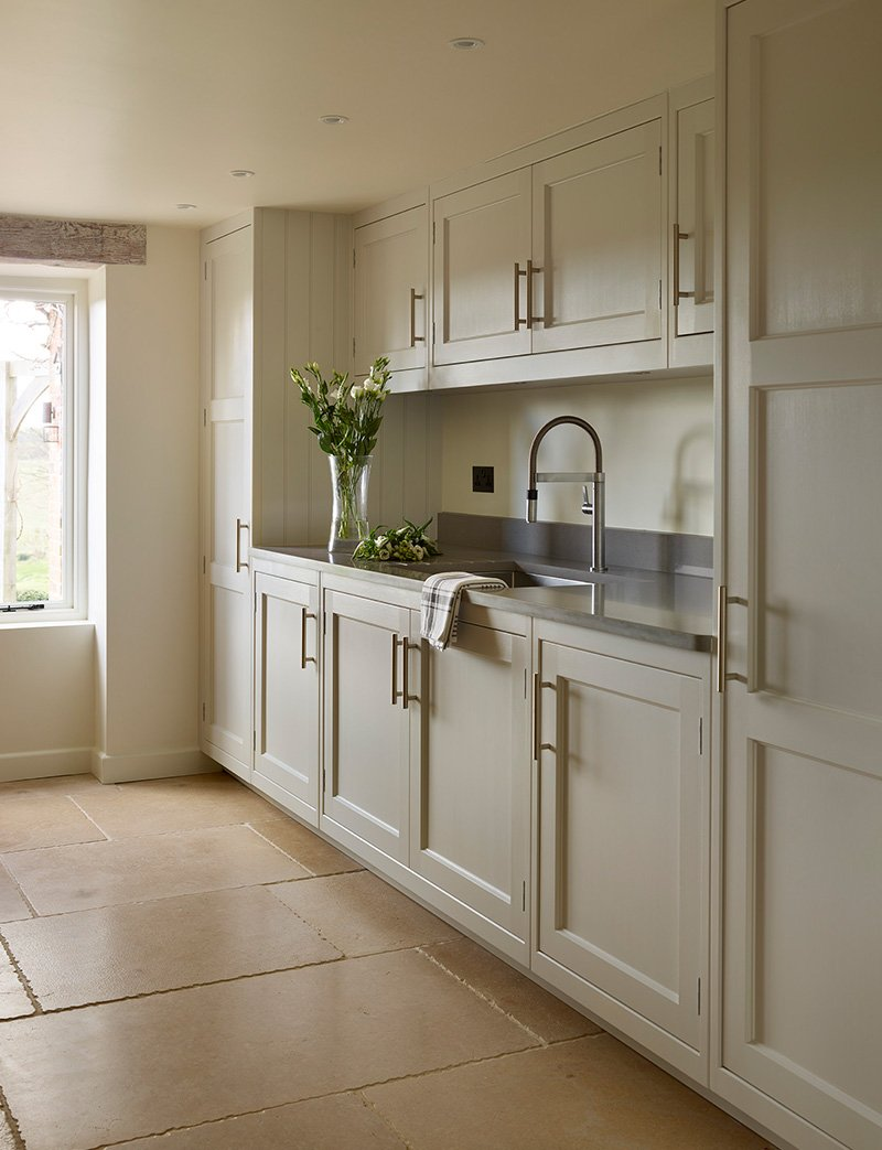 utility room with storage and sink