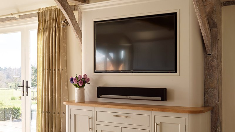wall mounted television and sound speaker