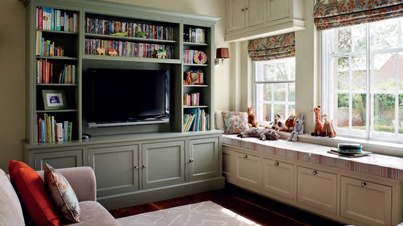 wall mounted tv with book storage