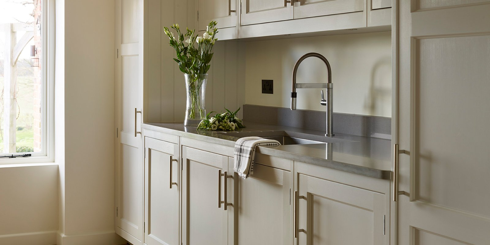 wall units with sink and vase of flowers