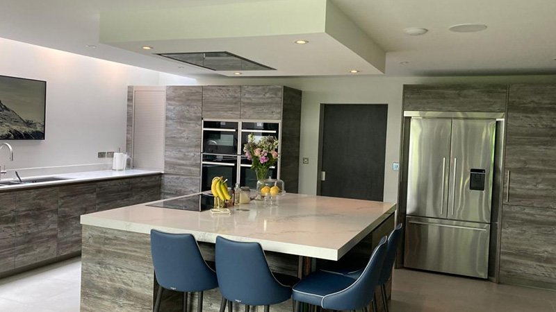 new kitchen with island and large kitchen appliances
