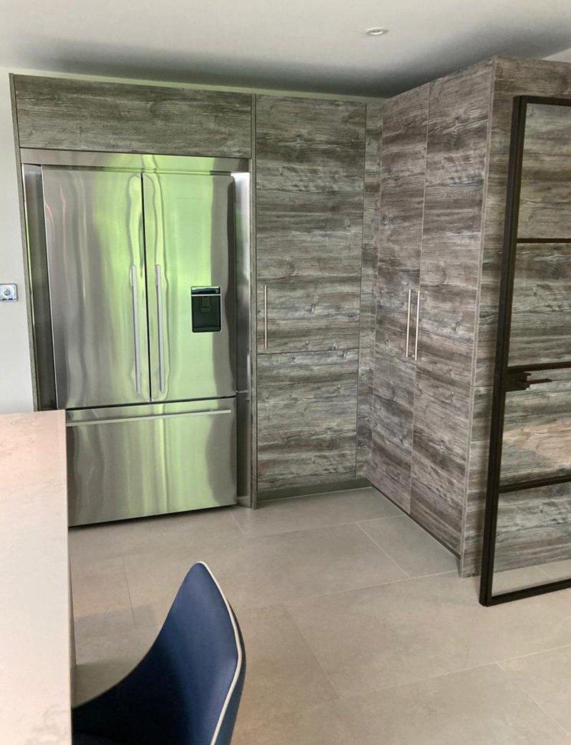rational kitchen with large fridge freezer
